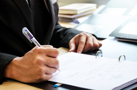 law suit: Business people who work hard and are signing the document