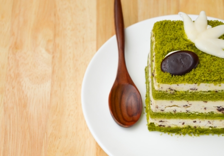 tea spoon: Matcha Chocolate Chip Cake on wooden table.