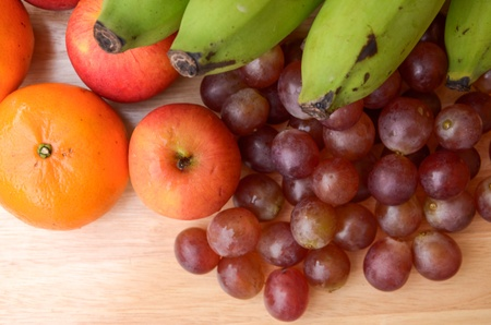 Fruits in autumn vintage still life, on wooden table background. Stock Photo
