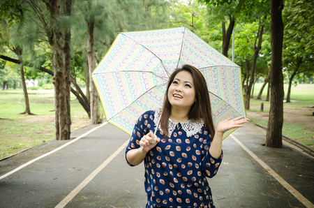 lightly rain with beautiful women on the road, at the park  Stock Photo