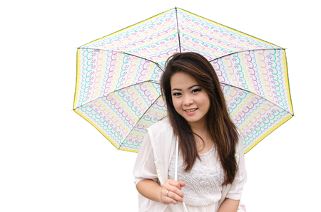 beautiful young  woman on white background with cute umbrella Stock Photo