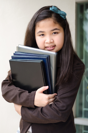 smiling business girl with folder, outdoor background.