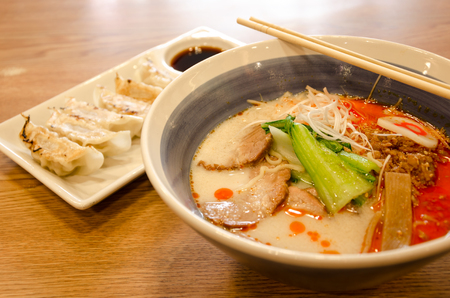 Japanese Ramen and Gyoza on wooden table.