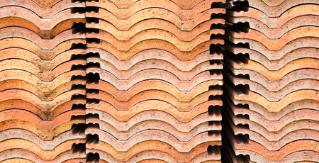 stack of ceramic roof tiles, white background.