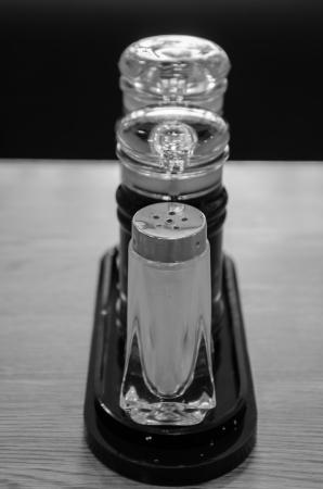 Soy Sauce, Sesame oil and pepper bottles on wooden table.