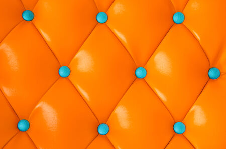 orange texture: Blue buttoned on the Orange Texture  Stock Photo