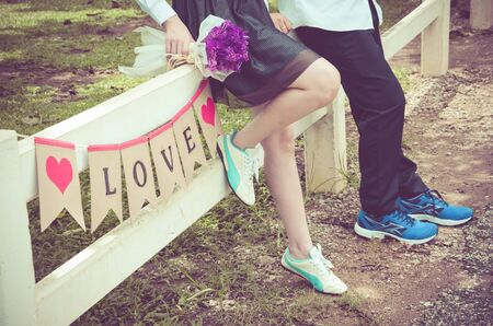 Young couple in love and love label. outdoor