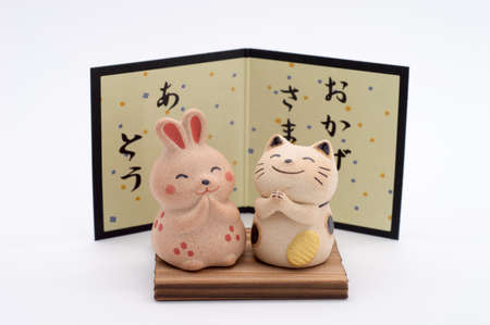 decorative item: Decorative item - Japanese Zen style happy rabbit and lucky cat Stock Photo