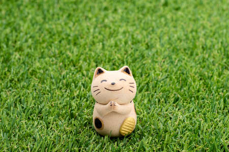interior decoration accessories: Decorative item - Japanese lucky cat praying on the grass