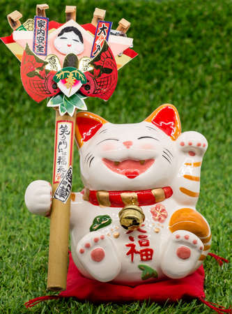 interior decoration accessories: Decorative item - Japanese lucky cat on the grass