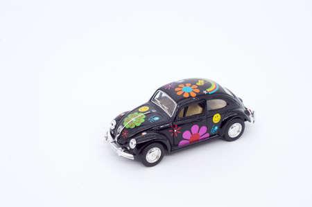 flower power: black color toy car - flower power design of wagon car Stock Photo