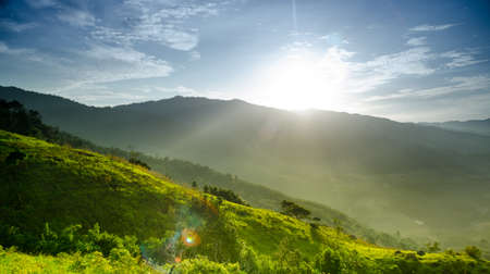 brighten: beautiful sun has rise up from the mountain and brighten up the world. Stock Photo