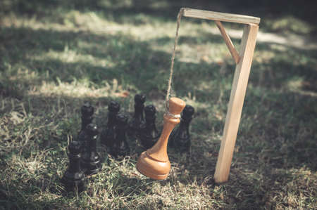 The chess king is hanged on the gallows. The concept of revolution, removal from power, overthrow of the regime, political reprisals. The overthrow of the monarch