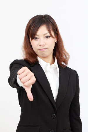 Young japanese business woman showing thumb down photo