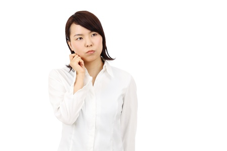 Portrait of young asian business woman thinking photo