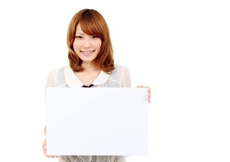 Young asian business woman holding empty white board