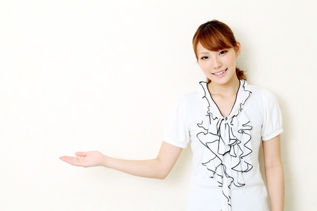 Young asian woman hand showing blank sign Stock Photo