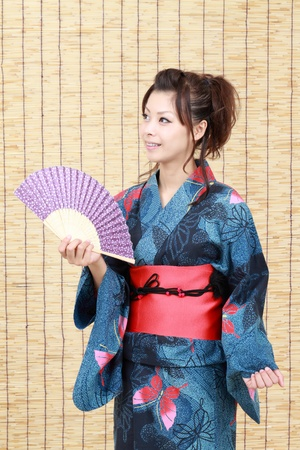 Japanese woman in traditional clothes of Kimono with japanese fan  Stock Photo