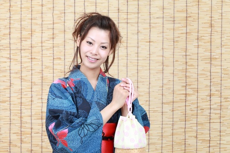pochette: Japanese woman in traditional clothes of Kimono with bag
