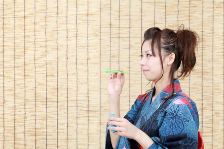 Japanese woman in traditional clothes of Kimono, blowing soap bubbles Stock Photo - 10202114