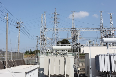 isolator switch: Electric power transformation substation with blue sky