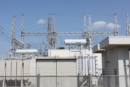 substation: Electric power transformation substation with blue sky