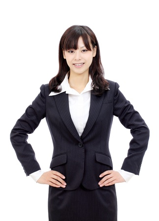 Beautiful asian businesswoman standing with hands on hips photo