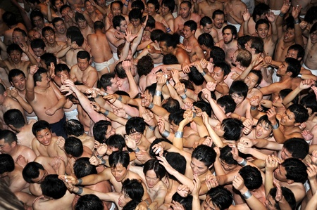 Okayama, Japan - Jan 26th, 2008 - People of the nakedness of japanese are touching god at the traditional festival at Okayama Saidaiji Buddhist Temple.