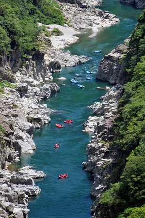 Tokusima, Japan - July 20: Action at river rafting competition game on Yosino river. July 20, 2008 in Tokusima, Japan.