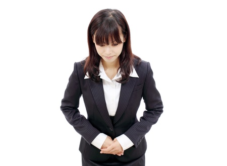 apology: Young japanese business woman making apology