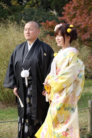 Kagawa, Japan - November 27: Japanese bride and groom in clothes of traditional wedding kimono, Japan to take wedding photos in Riturin Park, November 27, 2011 in Kagawa, Japan. Stock Photo - 11390242