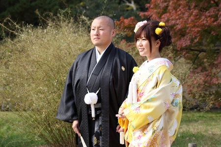 Kagawa, Japan - November 27: Japanese bride and groom in clothes of traditional wedding kimono, Japan to take wedding photos in Riturin Park, November 27, 2011 in Kagawa, Japan.
