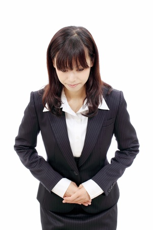 the etiquette: Young asian business woman making apology