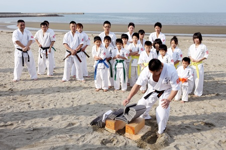 Ehime, Japan - January 3: Japanese martial art houses training of karate at the new year at the Ichinomiya beach. January 3, 2012 in Ehime, Japan.