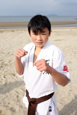 Ehime, Japan - January 3: Japanese martial art houses training of karate at the new year at the Ichinomiya beach. January 3, 2012 in Ehime, Japan. 新聞圖片