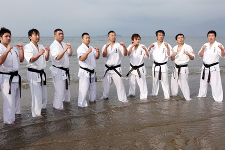 Ehime, Japan - January 3: Japanese martial art houses training of karate at the new year at the Ichinomiya beach. January 3, 2012 in Ehime, Japan. Stock Photo - 11829239