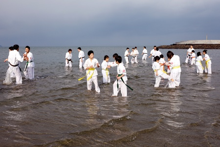Ehime, Japan - January 3: Japanese martial art houses training of karate at the new year at the Ichinomiya beach. January 3, 2012 in Ehime, Japan. Stock Photo - 11829243
