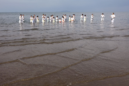 Ehime, Japan - January 3: Japanese martial art houses training of karate at the new year at the Ichinomiya beach. January 3, 2012 in Ehime, Japan. Stock Photo - 11829241