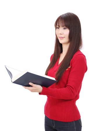 Portrait of young asian woman reading book photo