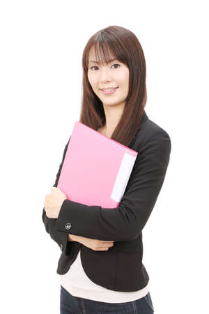 Young asian businesswoman holding a file document Stock Photo - 12052596