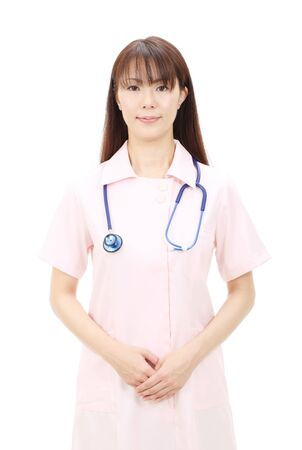 Young asian female nurse with hands crossed Stock Photo - 12052587
