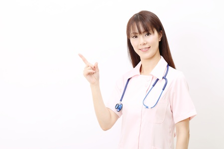 Young asian female nurse pointing photo