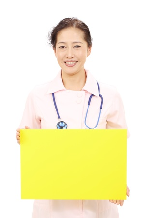 Asian female nurse holding a blank white board photo
