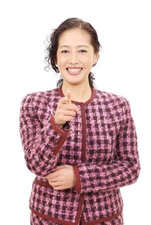 Portrait of asian business woman pointing photo