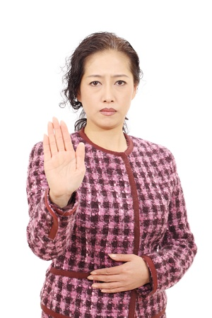 Asian businesswoman making stop sign Stock Photo