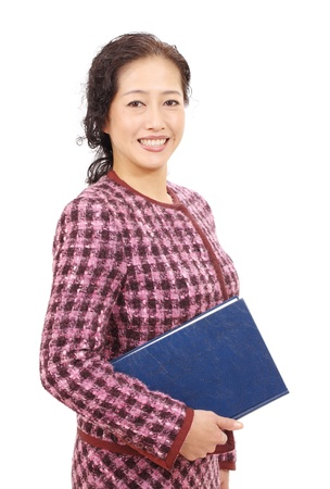Asian businesswoman holding book photo