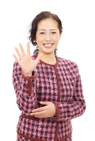 Asian woman smiling and showing her hand photo