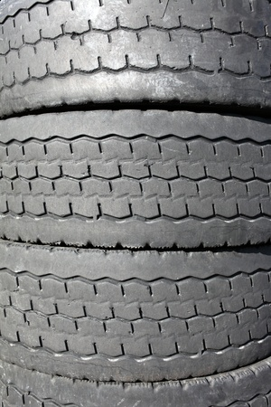 Pile of old car tires for rubber recycling photo