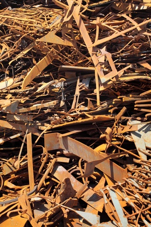 discarded metal: Pile of scrap metal at a recycling facility