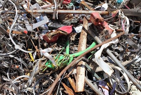 Pile of scrap metal at a recycling facility photo